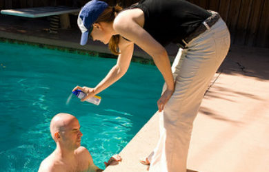 spraying sunscreen on bald head, spraying sunscreen, sun safety, spf, summer safety, summer outdoor safety, sunburns, mosquitos, zika virus, west nile virus, lyme disease, travel nurse, temporary medical staff, medevac