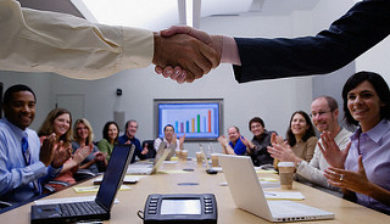 people meeting at work, office boardroom, two people shaking hands in a meeting at work, employee generational differences in learning, generational differences, generational diversity, employee learning, employee training