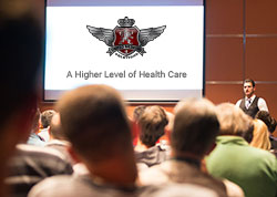 people listening to a guest lecturer with UMS logo on screen, healthcare guest lecture, healthcare trainers, healthcare training, critical care training, helicopter rescue training