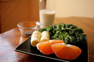 plate of healthy food including oranges, bananas, leafy greens, and a glass of milk, healthy food, nutrition, national nutrition month, united medevac solutions, ums