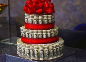 a cake made out of dollar bills, money, graduates earn more money, earn more money in healthcare, healthcare jobs, healthcare, staffing, healthcare staffing, jobs, money in healthcare jobs