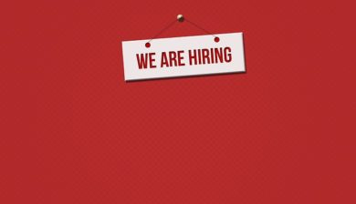 we are hiring sign hanging on a red wall, we are hiring, hiring in georgia, ums, united medevac solutions, healthcare, government contract