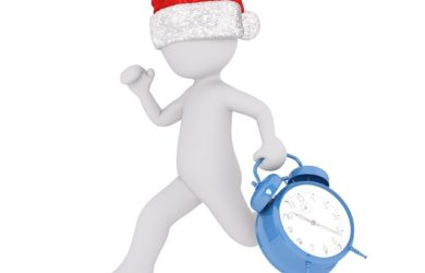 figure in santa hat running with an alarm clock, holiday stress, united medevac solutions, ums
